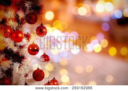 Christmas yellow circle lights against christmas tree with copy space