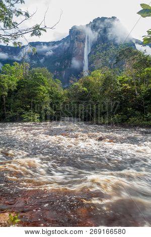 River Churun And Tepui Table Mountain Auyan With Angel Falls In National Park Canaima, Venezuela