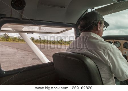 Canaima, Venezuela - August 18, 2015: Pilot Of A Small Cessna 300 Adf Airplane At The Airport Of Can
