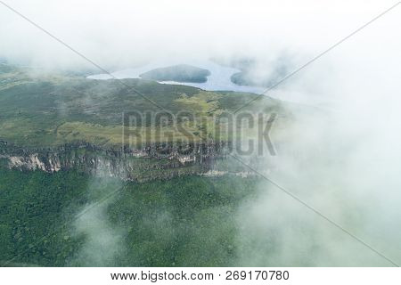 Aerial View Of River Caroni And One Of The Tepuis Table Mountains In Venezuela