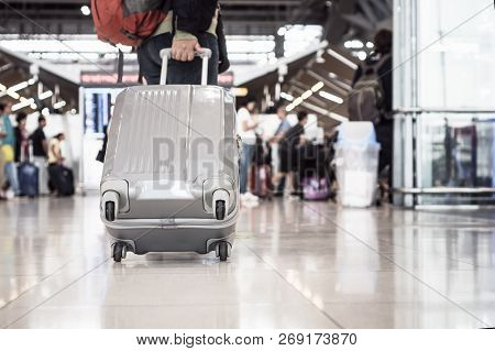 Traveling Luggage Walking At Airport Terminal For Checkin. Travel And Vacation Concept