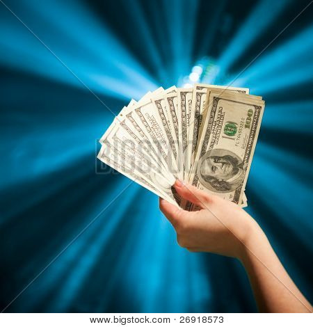 hand holding a 100 dollars banknotes poster