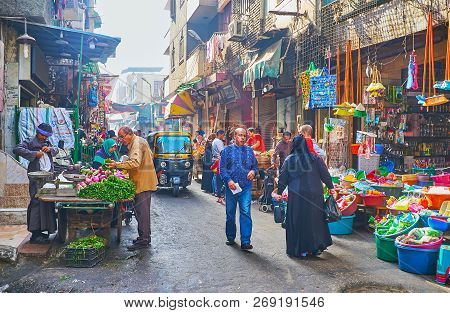 Cairo, Egypt - December 21, 2017: The Street Scene In Al Khayama Bazaar With Food And Household Shop