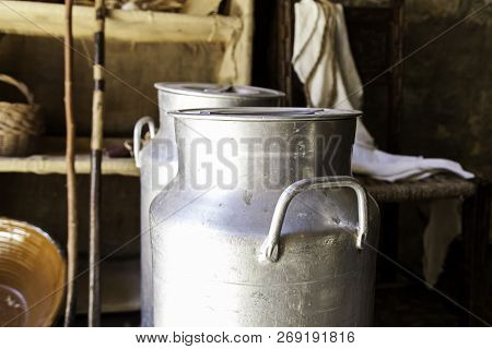Antique Metal Containers For Milk, Detail Of Objects On A Farm