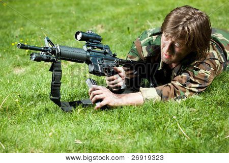 soldier in the field reloading the gun
