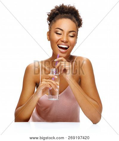 Laughing Girl Drinks Clean Water. Photo Of Young African American Girl Isolated On White Background.