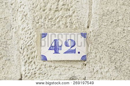 Number Forty-two, Detail Of A Number Of Information On A Wall Of A House Number
