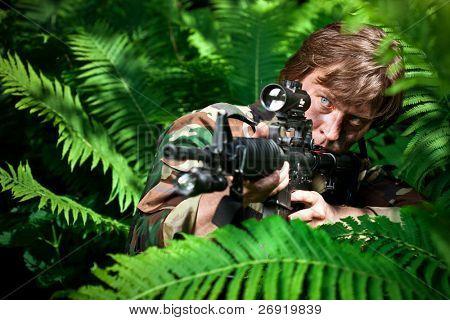 soldier aiming a gun