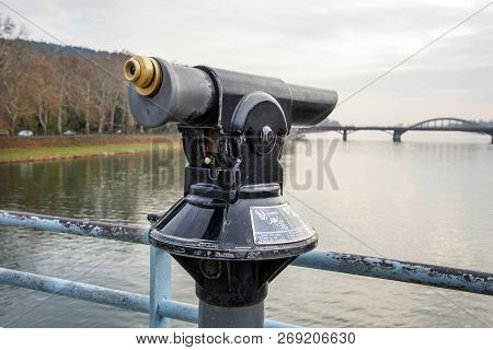 Monocular On The Bridge In The City