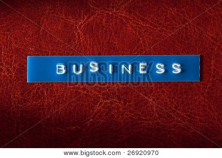 business text on leather background