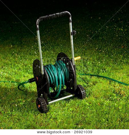 watering garden hose on the spool