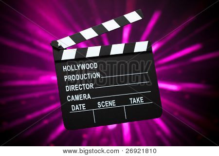 clapperboard on shiny background