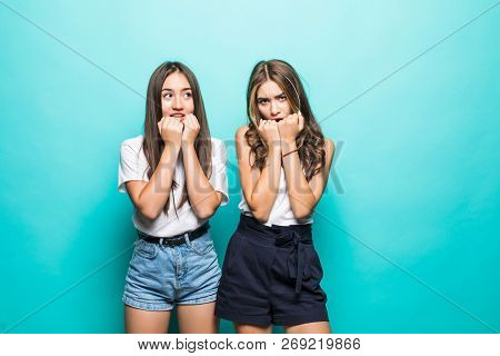 Scared Emotive Multiethnic Women Stare At Camera With Bewilderment, Keep Hands Near Mouthes, Notice