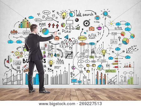 Businessman Drawing Business Plan Sketch
