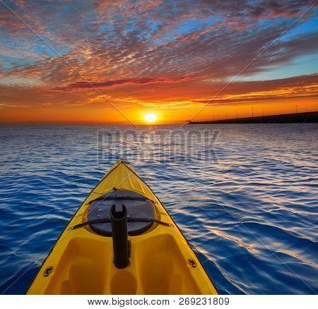 Kayak sailing in ocean sea at sunset or sunrise