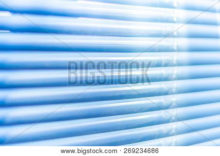 Closed Blue Shutters, Macro Shot. Jalousie Background. Sunlight Through Horizontal Blinds.