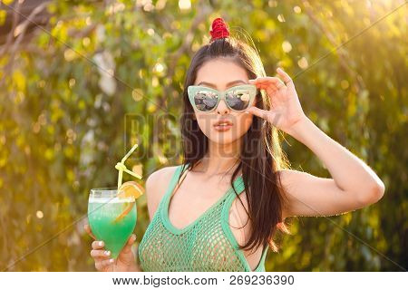 Beach Woman Drinking Cold Drink Beverage Having Fun At Resort Outside. Portrait Of Beautiful Young A
