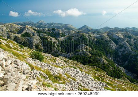 Very Curvy Road To The Steep Mountain Peak Of Sveti Jure In Front Of Hills And Rocks Of Biokovo Moun
