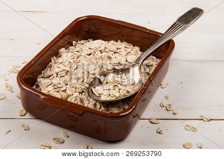 Traditional Irish Oatmeal In A Brown Bowl With Spoon