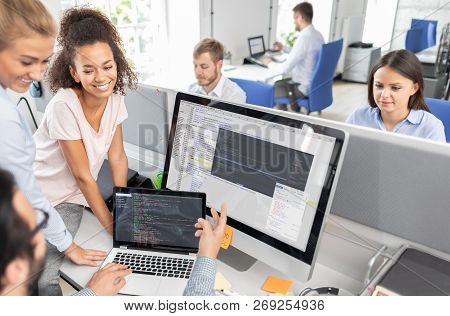 Developing Programming And Coding Technologies. Website Design. Programmer Working In A Software Dev