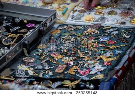 Collection Of Old Brooches At The Flee Market
