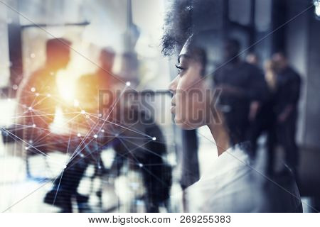 Businesswoman At The Office Looks Through The Window For The Future. Double Exposure