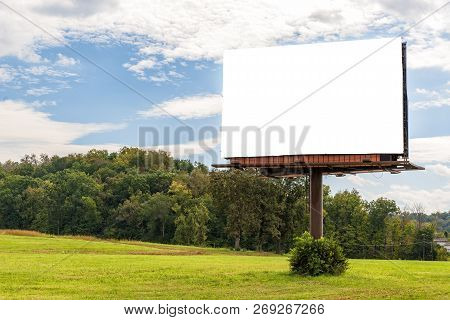 Horizontal Shot Of A Giant Blank Billboard Mounted On A Pole In An Autumn Setting With Copy Space.