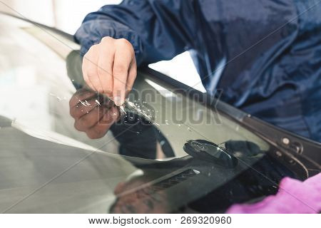 Close Up Car Glaze Worker Fixing And Repairing A Windshield Or Windshield Of A Car At A Garage Servi