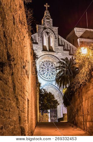 Sant Jaume Church And Medieval Fortification Wall At Old Town Alcudia, Majorca Spain At Night