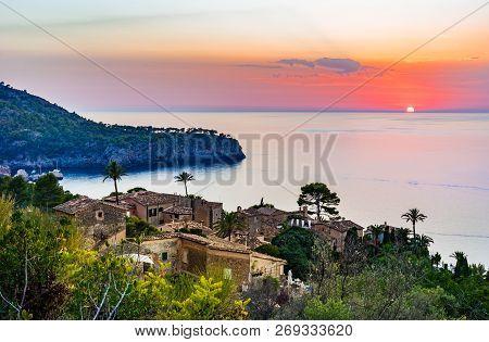Beautiful View Of Old Rustic Mediterranean Village At The Coast Of Deia On Majorca, Spain Mediterran