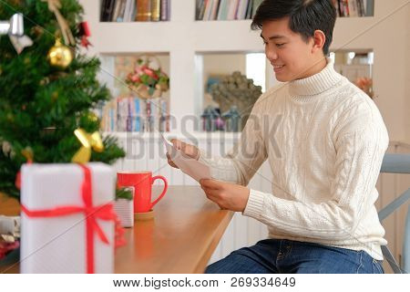 Man Wearing Cream Sweater Opening Sending Christmas Letter Greeting Card Holiday Wishes With Xmas De