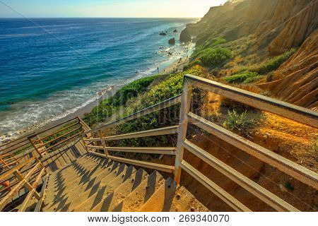 Scenic Wooden Stairway Leading Down To El Matador State Beach At Sunlight. Pacific Coast, California