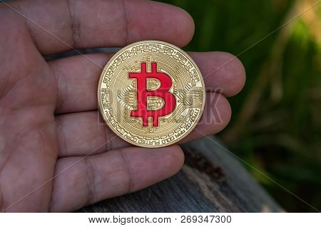 bitcoint monet on hand. new currency in modern business world concept. poster