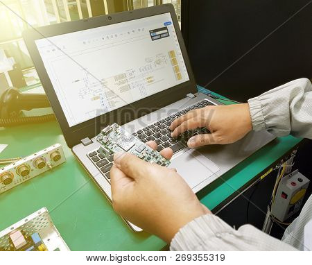 Developing Programming And Coding Technologies. Electronic Engineer Working In A Software To Develop