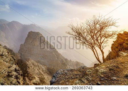 Barren landscape of Hajar mountains in Ras Al Khaimah,UAE at sunset