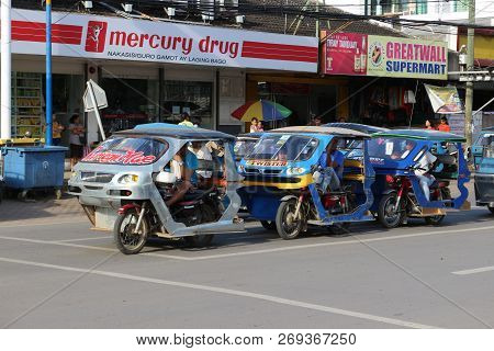 Palawan, Philippines - September 26, 2018: Tricycle Motorbike Taxi In Traffic Jam On City Street On
