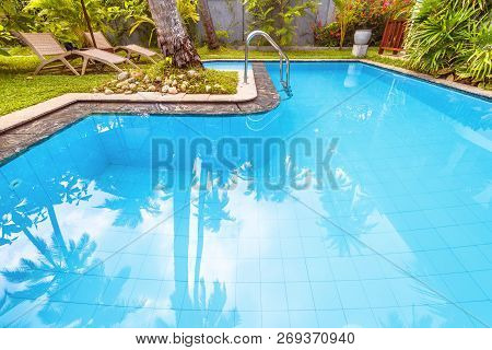Pool In Tropical Hotel Or Residential House. Nice Swimming Pool In Courtyard In Summer. Idyllic Plac