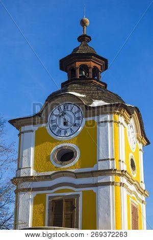 Сlock Tower In Ancient Spisska Kapitula On Background Blue Sky At Winter. Spisske Podhradie, Slovaki