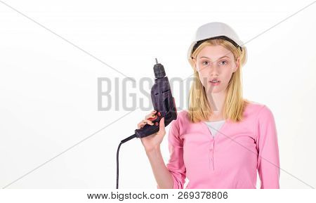 Woman builder worker with drill. Young sexy woman holds construction drill. Girl in hardhat with drill. Female construction worker with electric screwdriver. Woman in safety helmet with drill machine. poster
