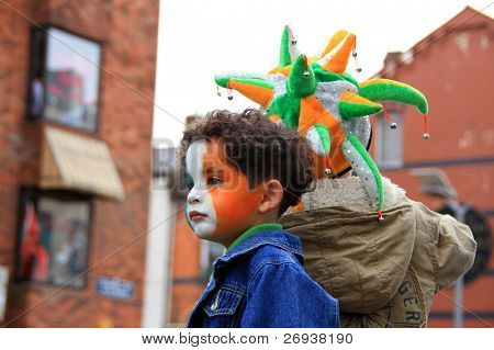 LIMERICK, IRELAND - MARCH 17: Unidentified child with a painted face in Irish colors participates in a parade for St. Patrick's Day on March 17, 2009 in Limerick, Ireland. It's a traditional Irish holiday parade.