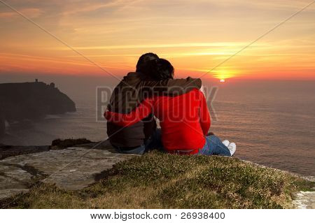 Loving Couple at sunset on irish Cliffs of Moher