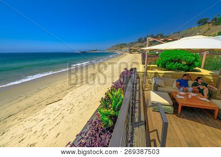 Malibu, California, United States - August 7, 2018: Couple Sitting At Luxurious Japanese Restaurant