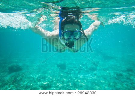 Young women at snorkeling in the Caribbean Sea