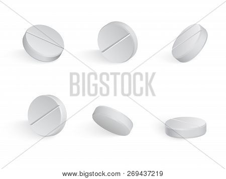 Round White Medical Tamblets In Different Positions.