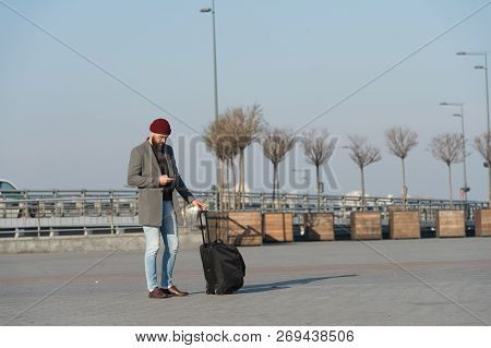 Traveler With Suitcase Waiting Transportation To Airport Railway Station. Ready To Travel. Carry Tra