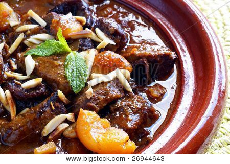 Morrocan beef stew with plums and dried apricots poster