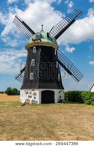 Wheat Windmill. Harvest Concent. The Stock Photo.