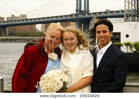 Just married couple with mother of bride