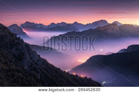 Mountains In Fog At Beautiful Night In Autumn In Dolomites, Italy. Landscape With Alpine Mountain Va