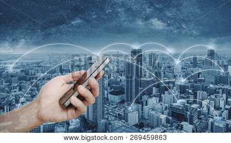 Hand Using Mobile Smart Phone, And Network Connection Technology In The City. Business Networking An